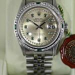 Rolex Datejust Lünette mit Smaragd und Diamanten besetzt